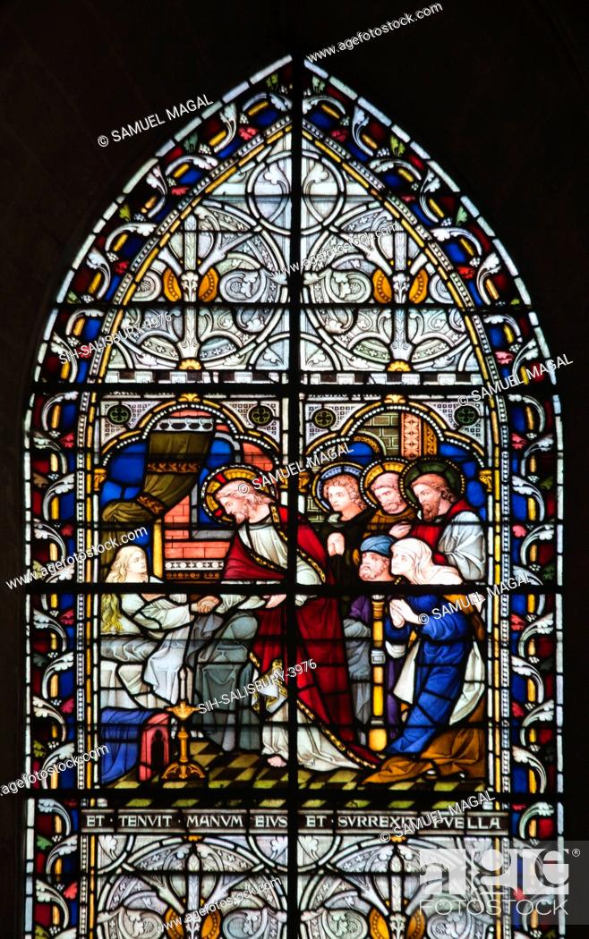 Stock Photo: A stained glass window, depicting a scene from Expositio in Matthaeum, a commentary on the Gospel of Matthew. It was written by Hrabanus Maurus.