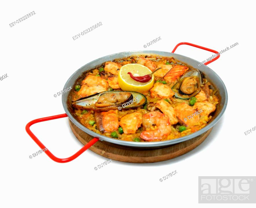 Stock Photo: Seafood hot dishes with clams, shrimp, fish and lemon in white background.