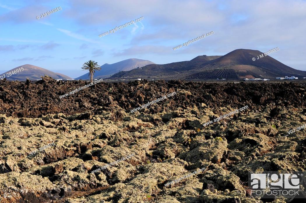 Stock Photo: Aa lava and volcanos. Los Volcanes Natural Park, Lanzarote Island, Las Palmas, Canary Islands, Spain.