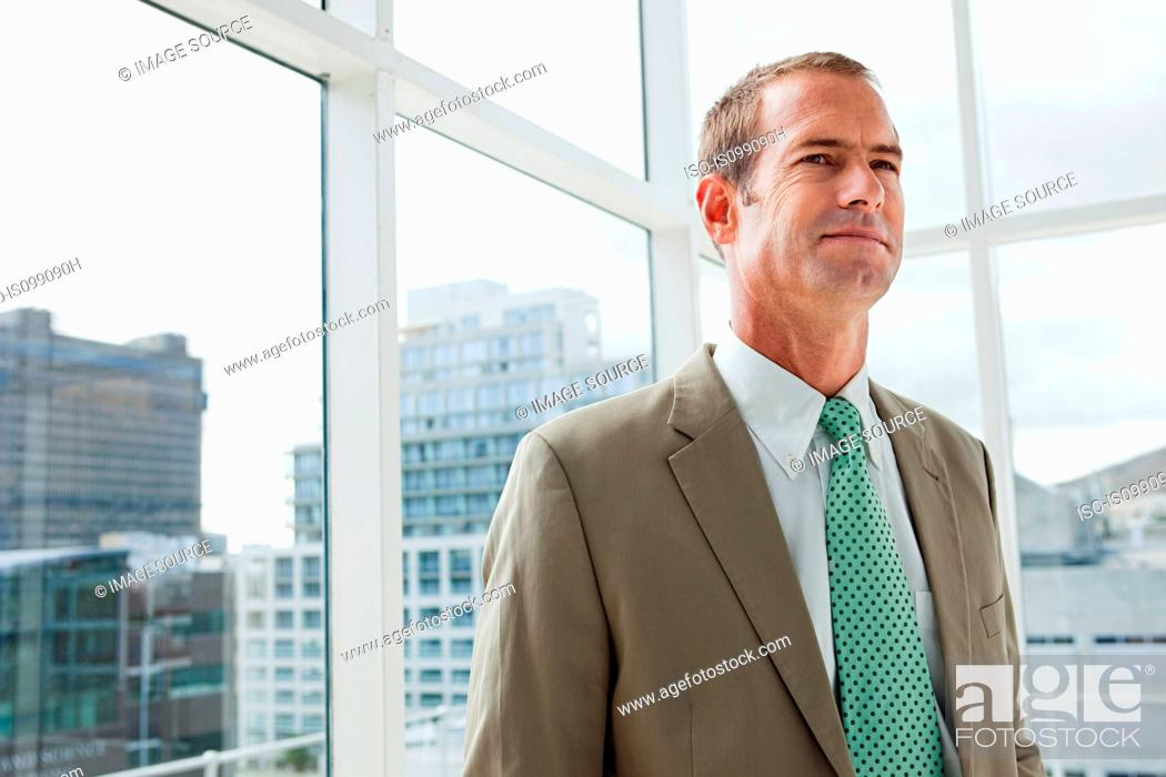 Stock Photo: Businessman in office, portrait.
