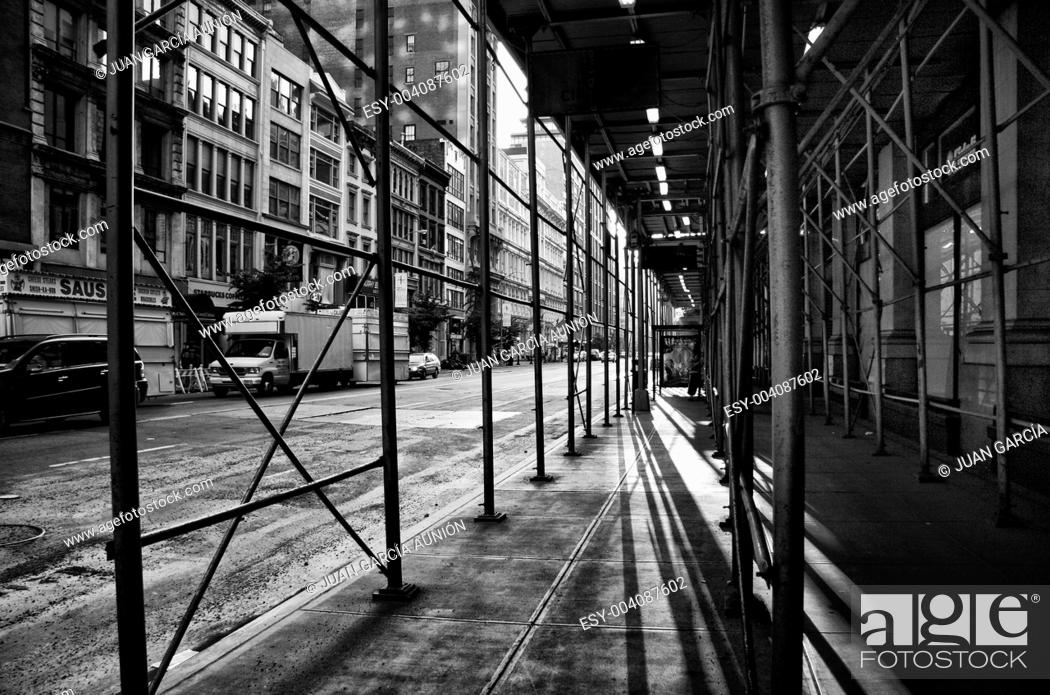 Stock Photo: Shadows under some scaffolding on a street in New York.