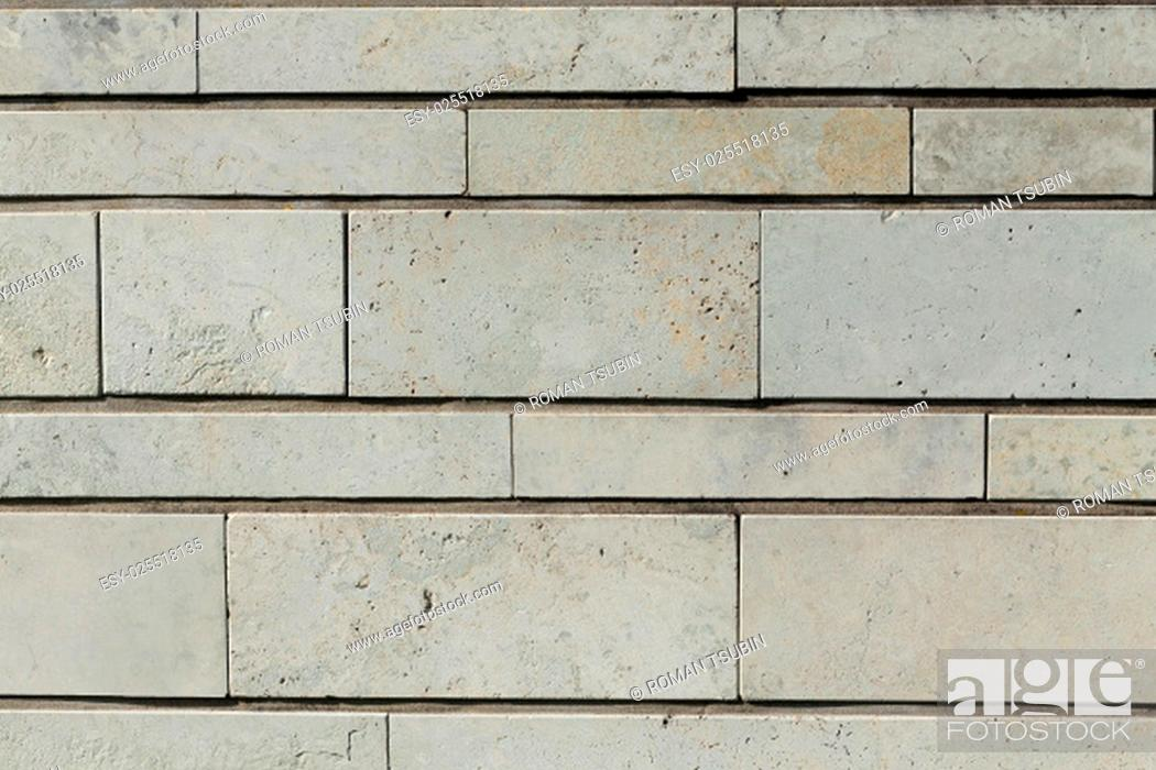 Stock Photo: new modern texture of a stone wall background.