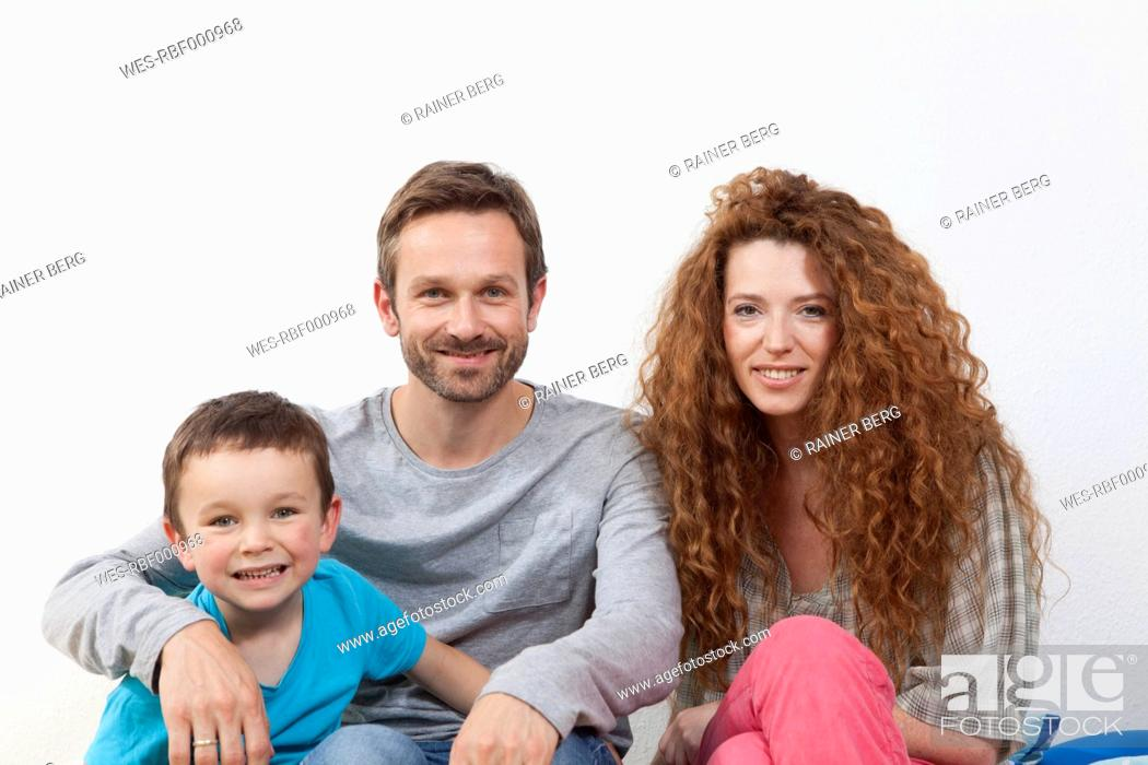 Stock Photo: Germany, Berlin, Close up of family, smiling, portrait.