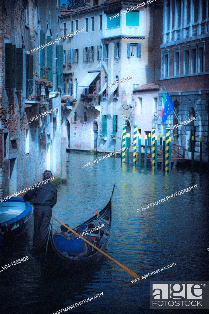 Stock Photo: Mystical view of a gondola with gondolier in Venice, Italy, Europe.