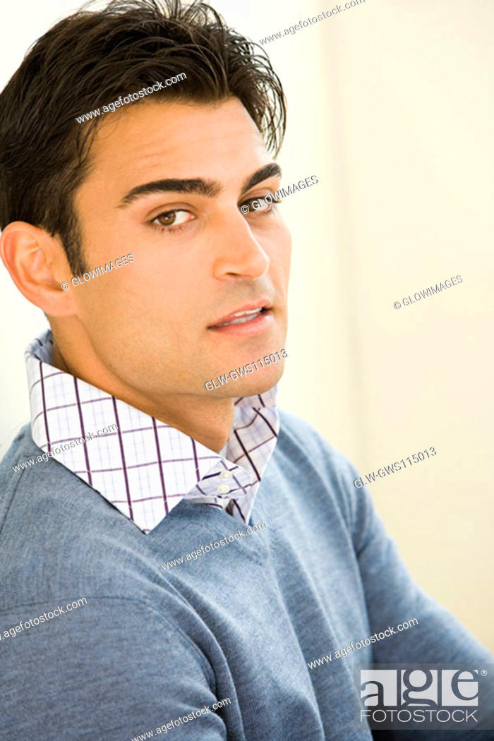 Stock Photo: Portrait of a mid adult man leaning against a wall.