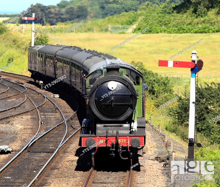 Stock Photo: LNER B12 8572 pulls into Weybourne Station on a hot summer's day. The North Norfolk Railway, North Norfolk, England, Europe.