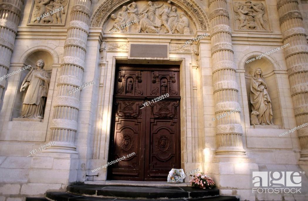 Stock Photo: Bunches of flowers left at the entrance of Saint-Étienne-du-Mont church, Paris, France.