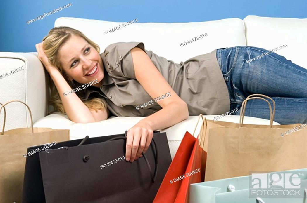 Stock Photo: Woman reclining on sofa.