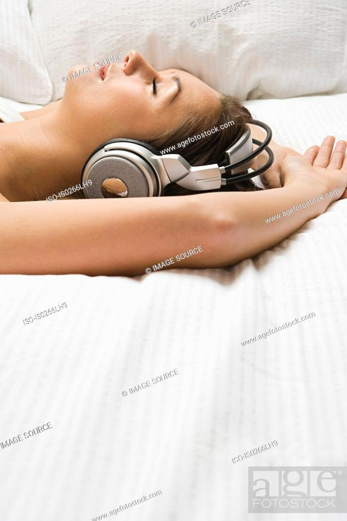 Stock Photo: Woman relaxing with headphones.