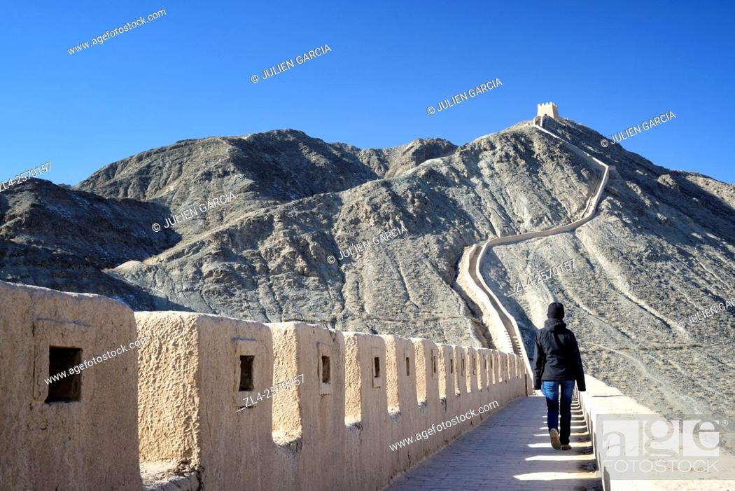 Stock Photo: China, Gansu Province, west end of the Great Wall of China, Overhanging Great Wall near Jiayuguan, Model Released.