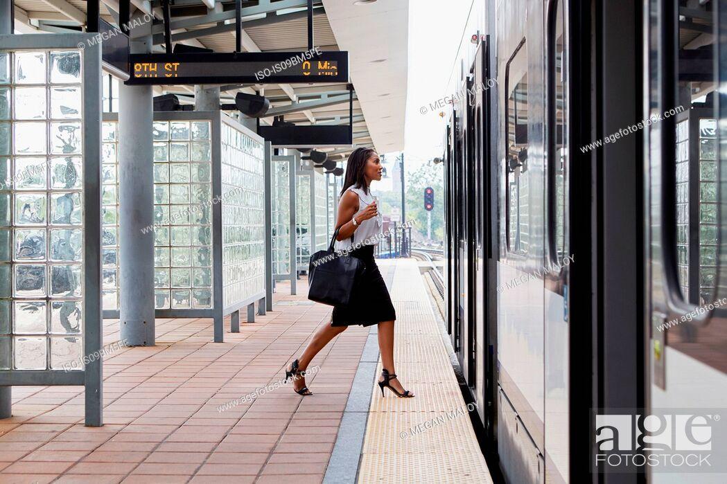 Stock Photo: Businesswoman boarding train.