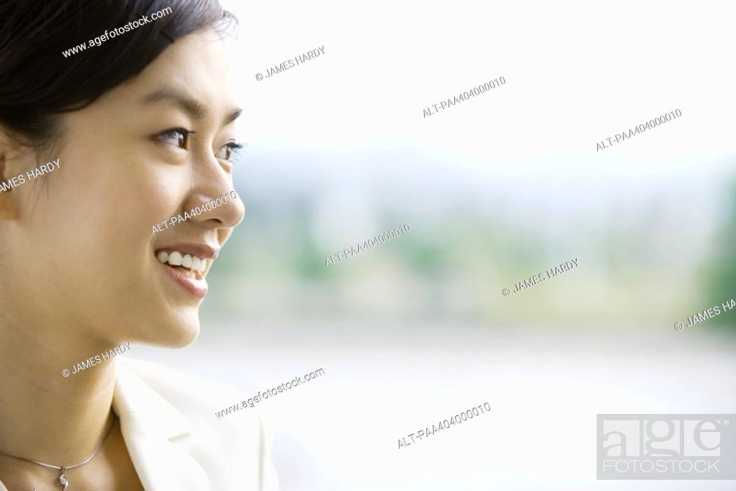 Stock Photo: Young woman smiling, portrait.
