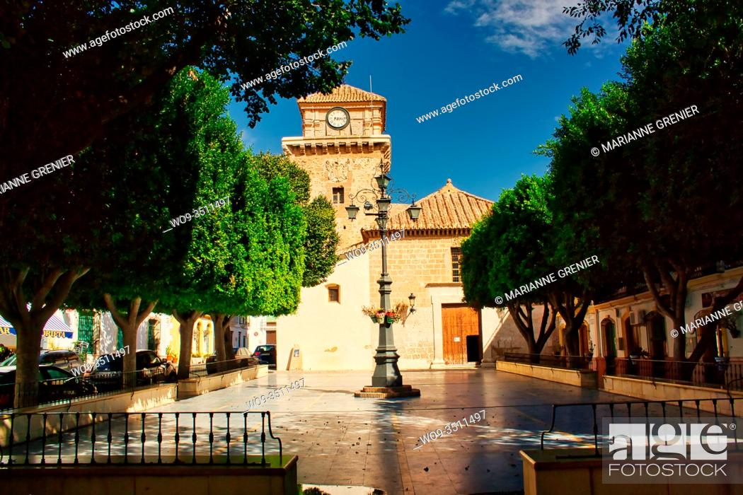 Stock Photo: Front view of Santa Maria Parish Church and the central square in Nijar, Spain.