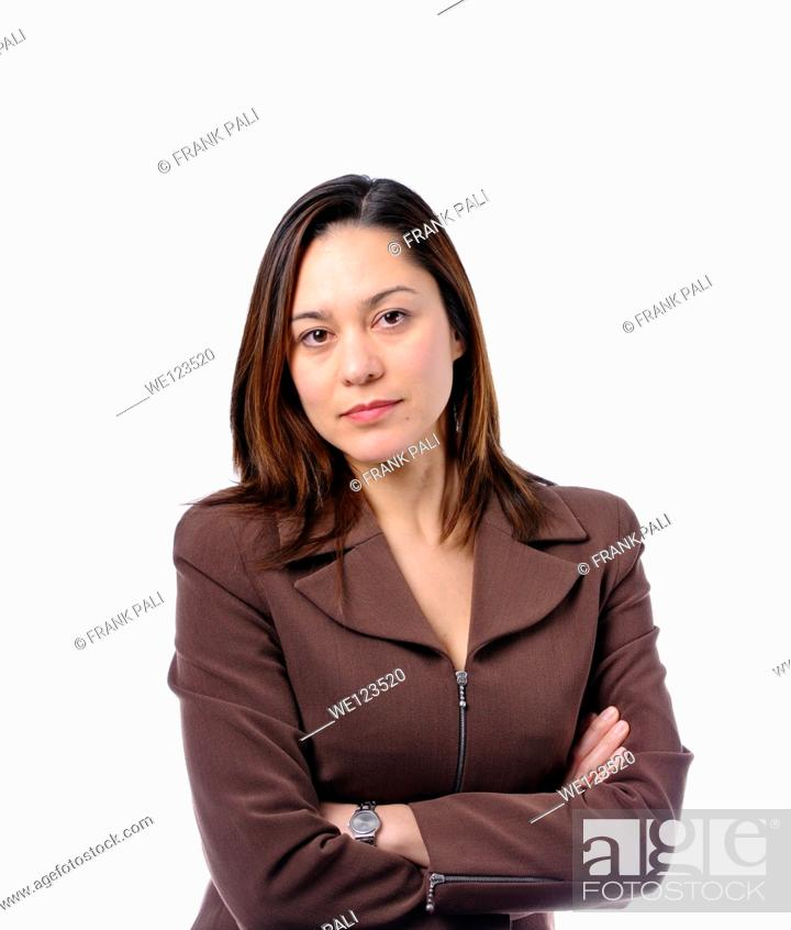 Stock Photo: Young women has her arms crossed She is of mixed race Wearing a brown suit and has long brown hair.
