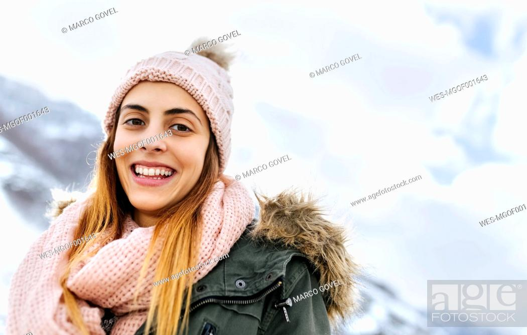 Photo de stock: Spain, Asturias, portrait of happy young woman in the snowy mountains.