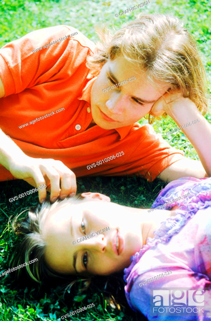 Stock Photo: Close-up of young couple lying in the grass together.