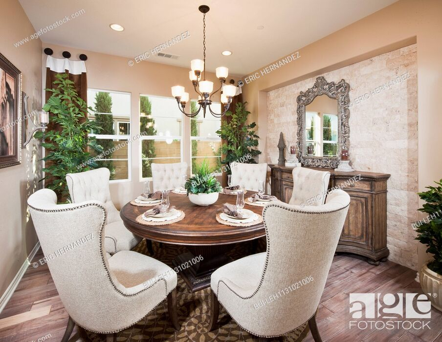 Imagen: Wingback chairs at dining table in house; Irvine; California; USA.