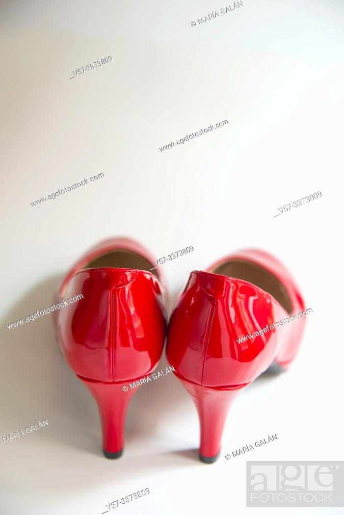 Stock Photo: Pair of red high heeled shoes.