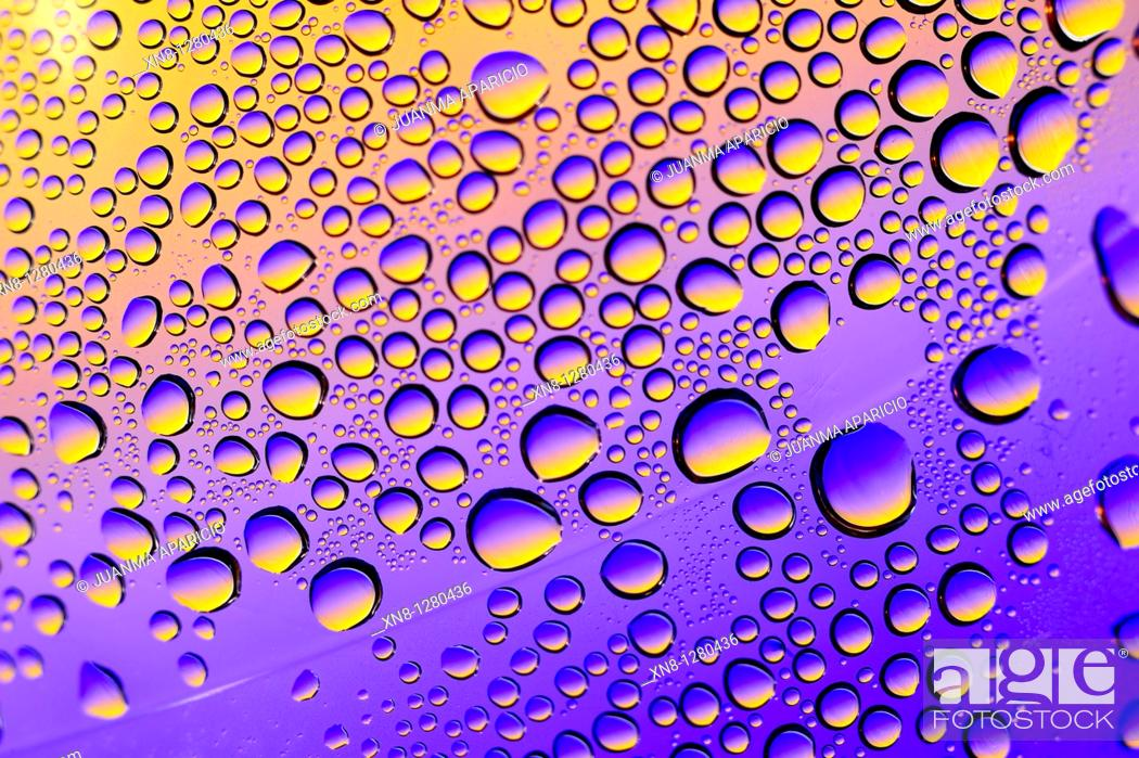 Stock Photo: Water drops on a gradient background color.