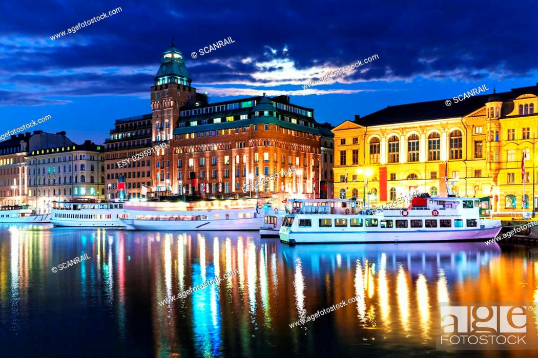 Stock Photo: Scenic summer night panorama of the Old Town (Gamla Stan) architecture pier in Stockholm, Sweden.
