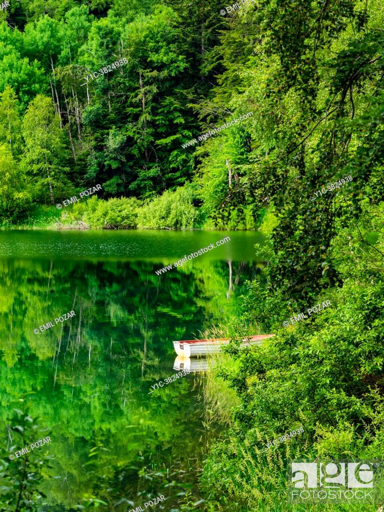 Stock Photo: Spring season lonely boat Lokve lake near Mrzla vodica in Croatia.