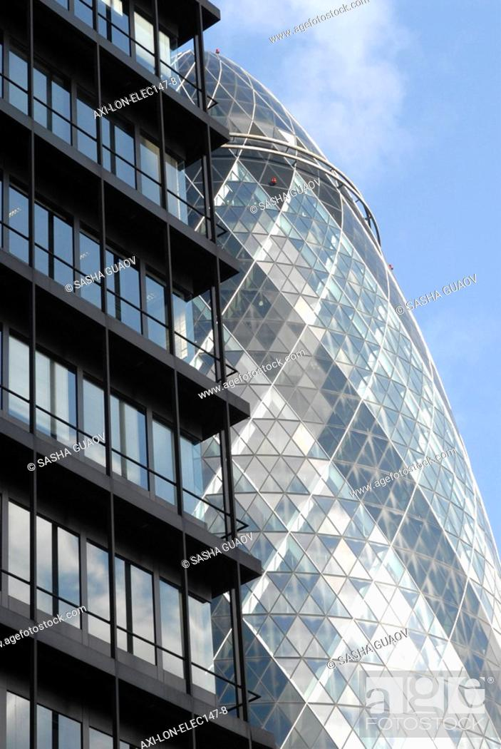 Stock Photo: Gherkin and office building.