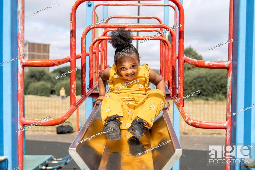 Stock Photo: Portrait of a smiling girl on a playground.