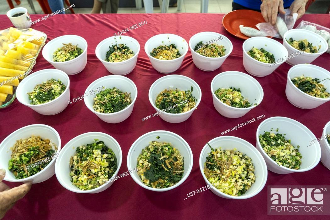Stock Photo: Chinese Hakka 'Lui Cha' mixed vegetables rice served at Sarawak Chai's Clan Association in Kuching, Sarawak, Malaysia.