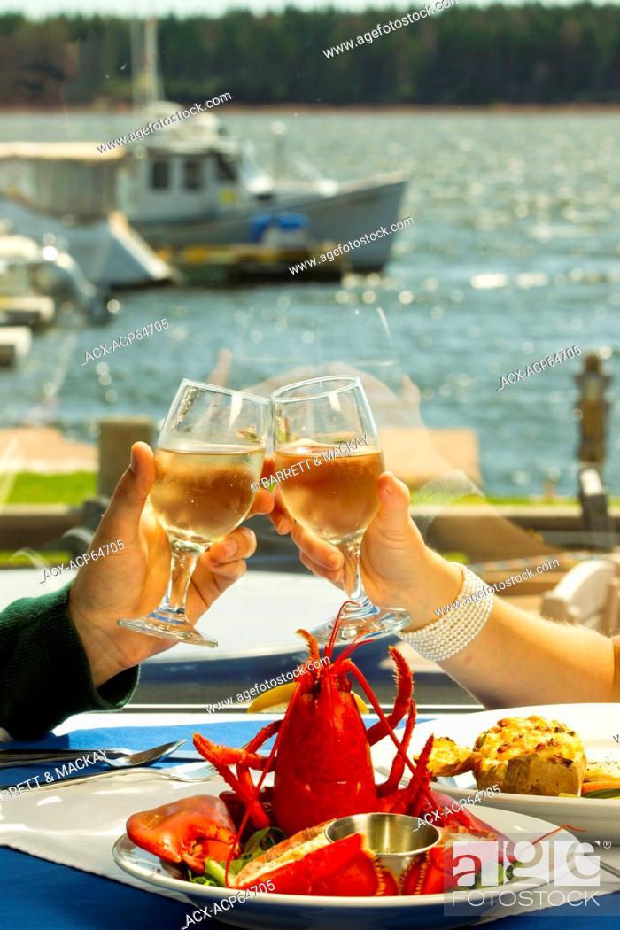 Stock Photo: Couple dining, Boat Shop steak & Seafood Restaurant Alberton, Prince Edward Island, Canada.