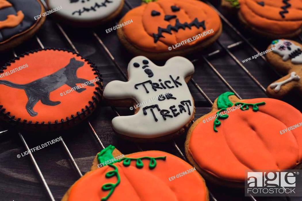 Stock Photo: composition of homemade halloween cookies on grid.