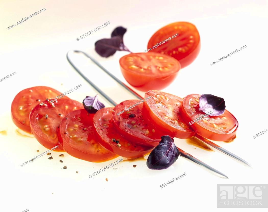 Stock Photo: Tomato salad with red basil.