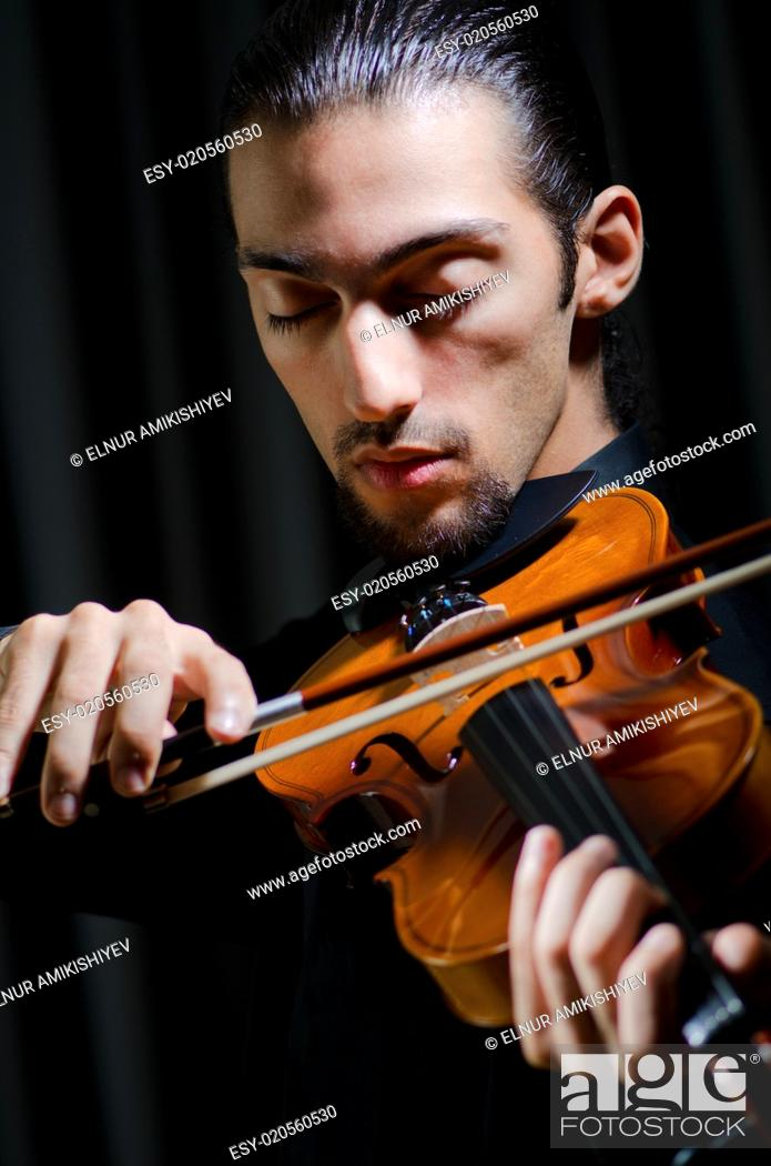Stock Photo: Violin player playing the intstrument.