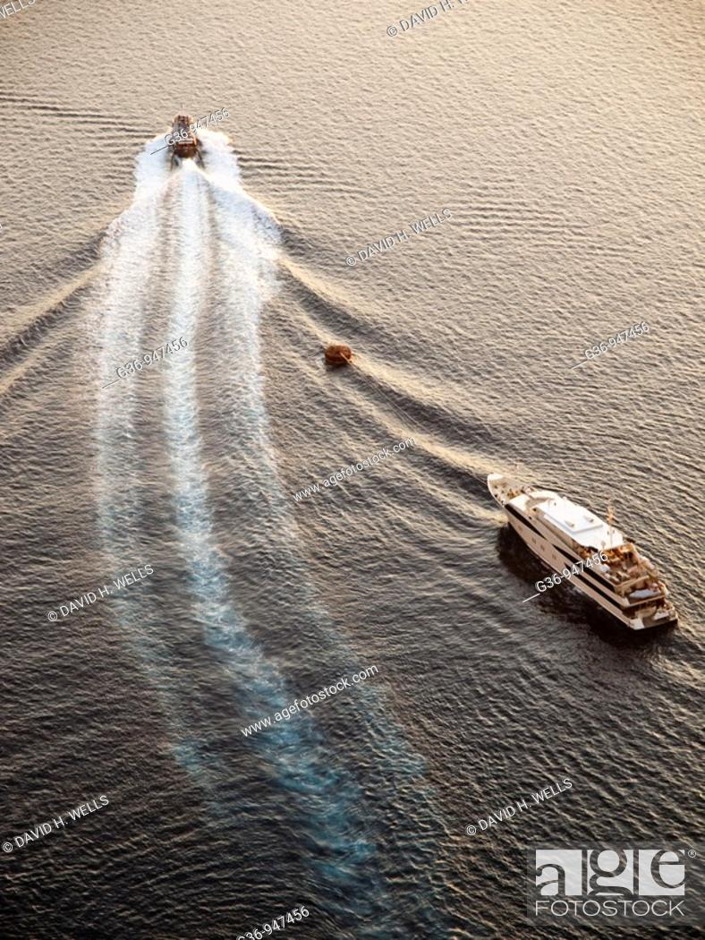 Stock Photo: Cruise ships visit Fira, Santorini, Greece.