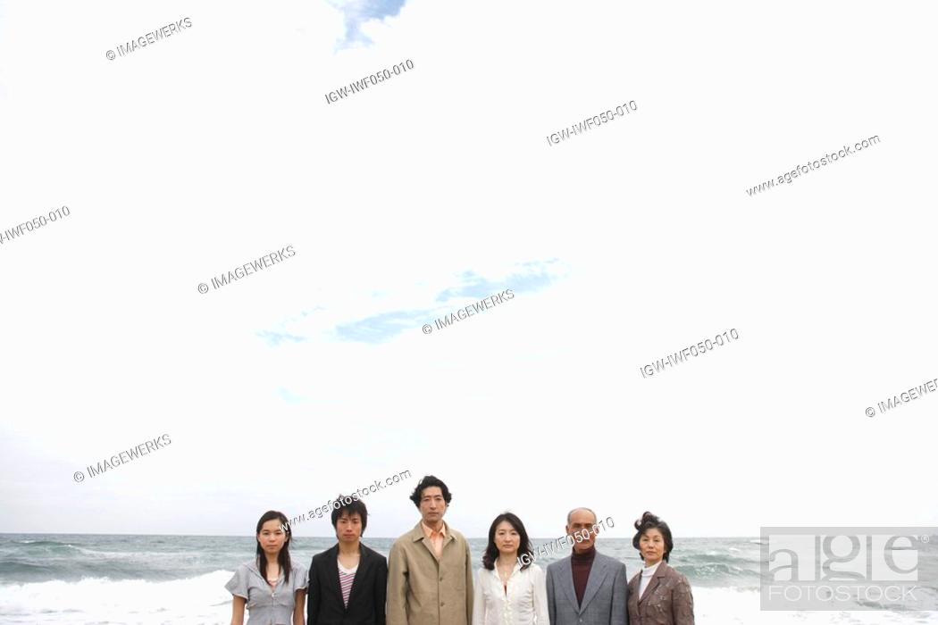 Stock Photo: Family standing together at beach.