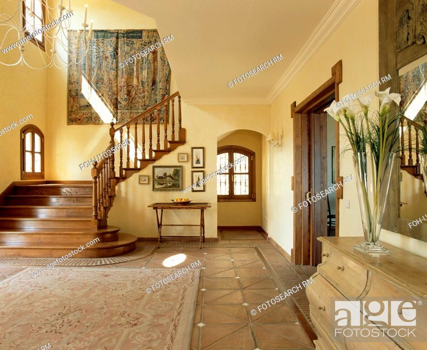 Stock Photo Patterned Rug On Terracotta Floor Tiles In Large Spanish Hall With Tapestry
