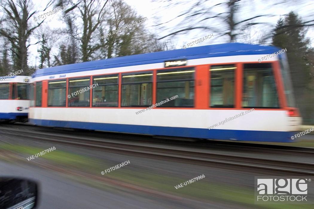 Stock Photo: rail, fast, red, travel, commute, transportation.