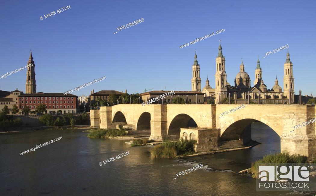 Stock Photo: Puente de Piedra Stone Bridge and Basílica de Nuestra Señora del Pilar Zaragoza Spain.