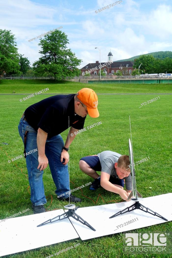 Stock Photo: Teacher Instructing Student to Launch Model Rocket, Wellsville, New York, United States.