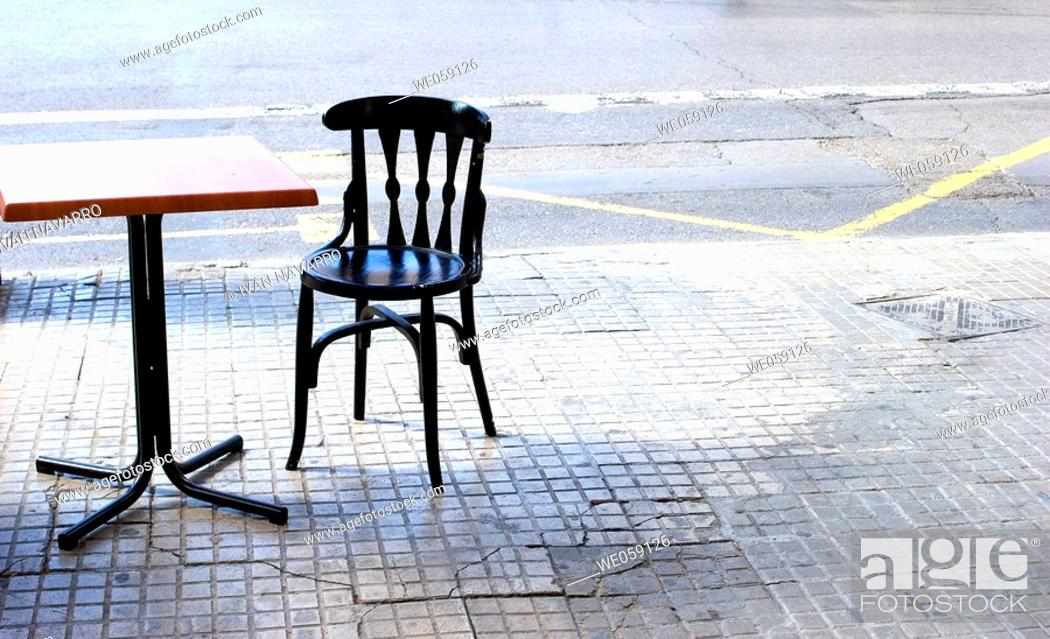 Stock Photo: Table and chair on the street.
