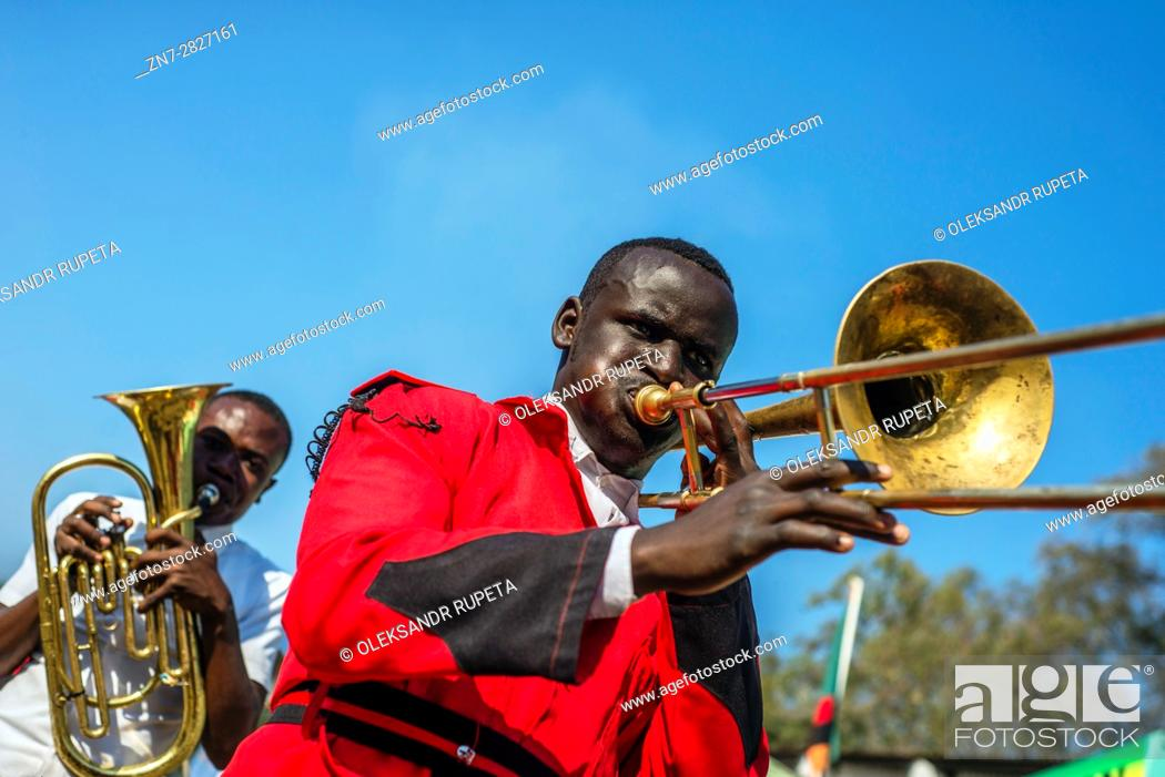 Stock Photo: Members of Zambian brass orchestra play music during Zambia International Trade Fair in Ndola.