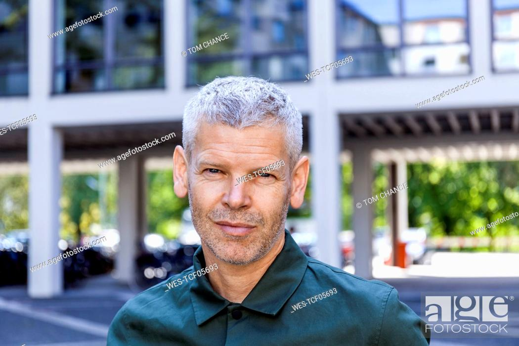 Stock Photo: Portrait of a confident mature man in the city.