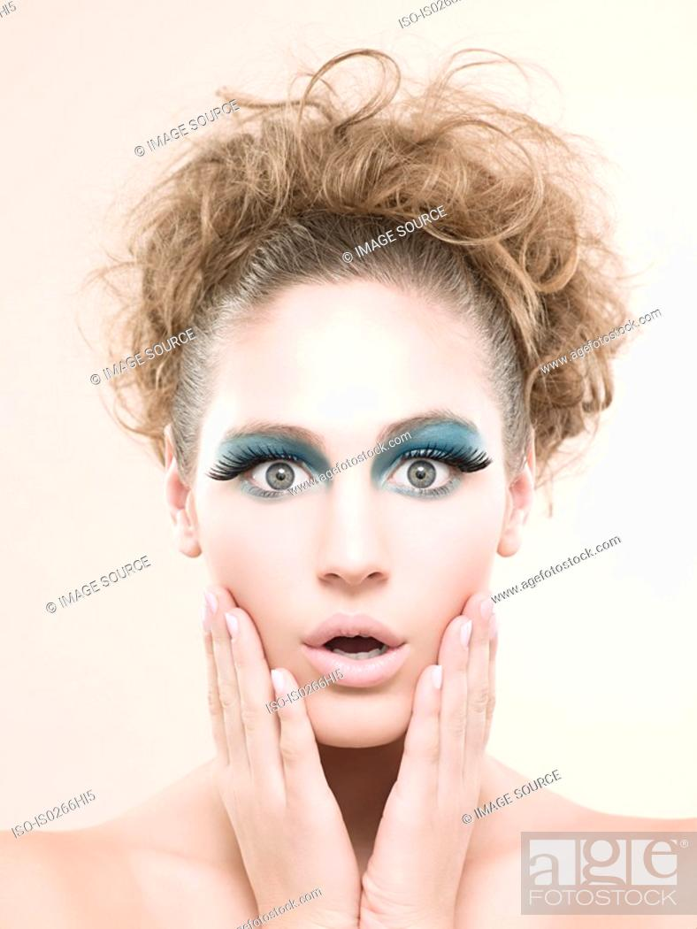 Stock Photo: Portrait of a young woman wearing false eyelashes.