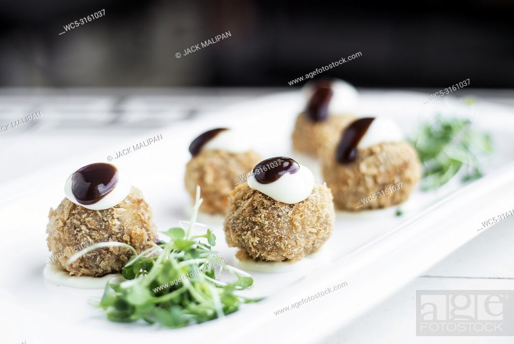 Stock Photo: gourmet organic scotch quail eggs modern starter snack dish on table.
