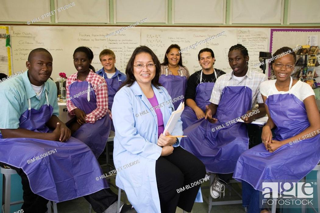 Stock Photo: Teacher and students in chemistry lab.