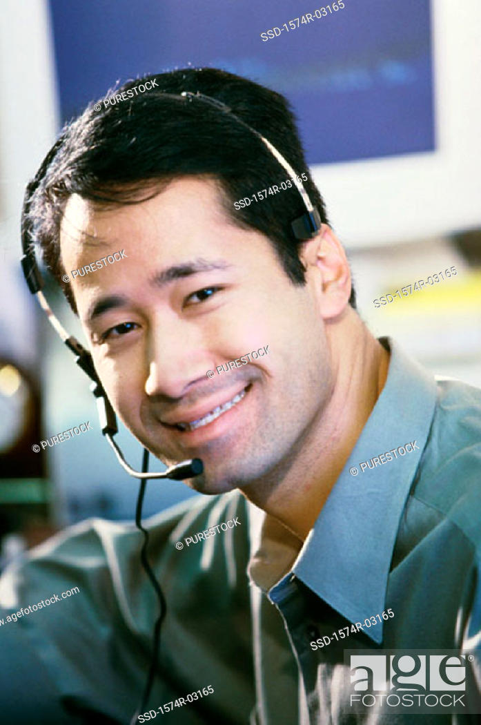 Stock Photo: Portrait of a businessman wearing a headset smiling.