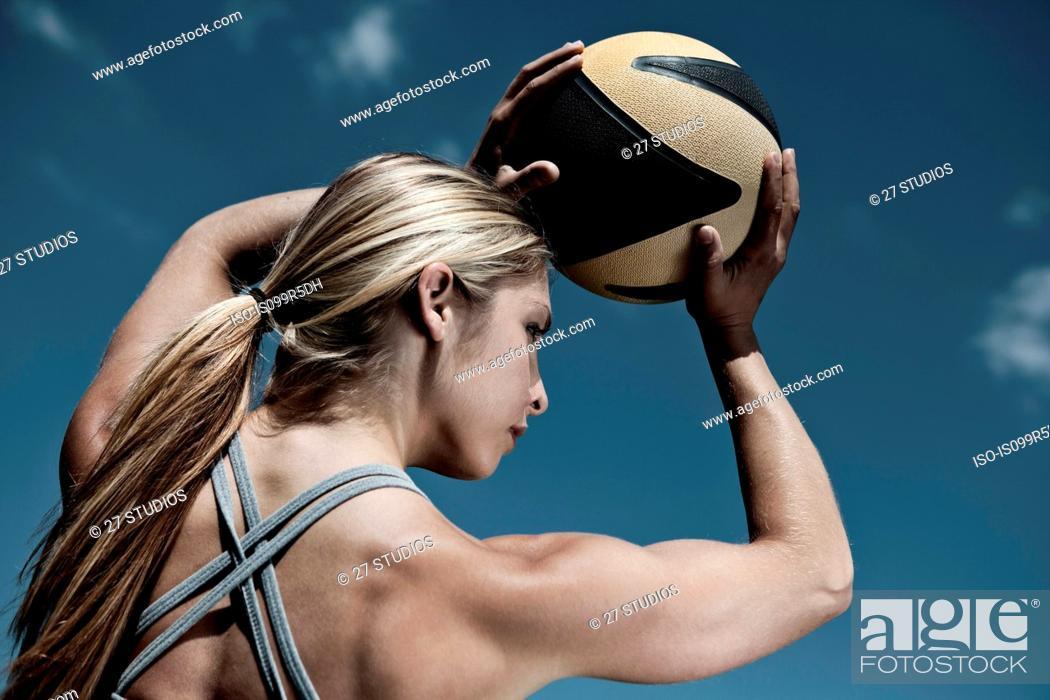 Stock Photo: Woman holding ball.