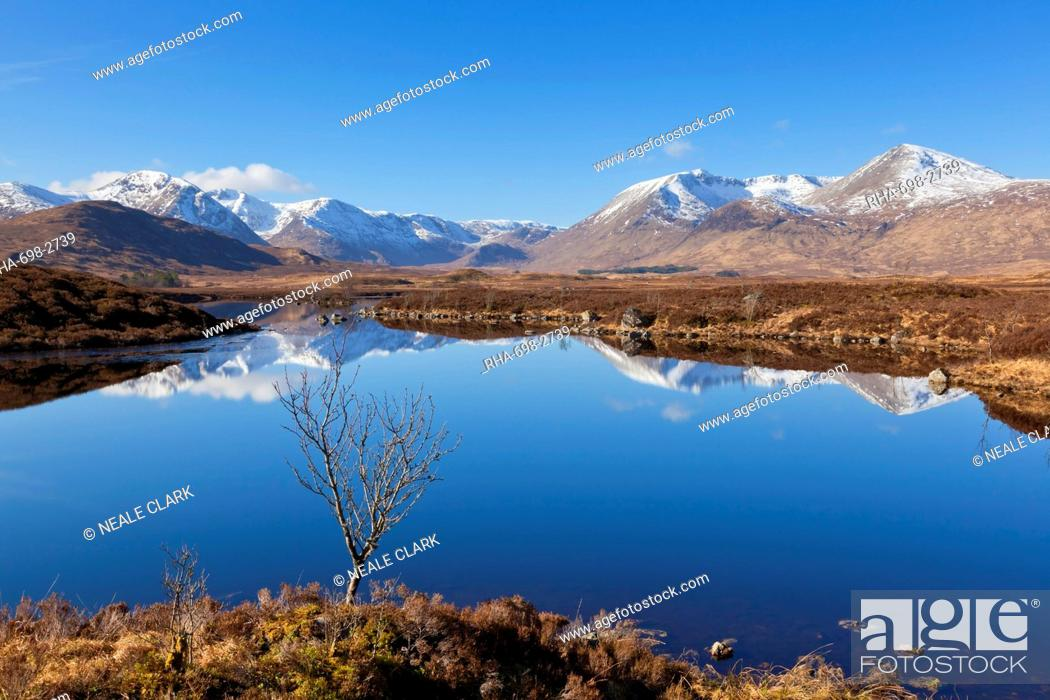 Stock Photo: Snow covered mountains left to right Stob a'choire Odhair, Aonach Mor, Beinn Mhic Chasgaig, and Meall a'Bhuirudh, around Lochan na h-Achlaise lower Rannoch Moor.