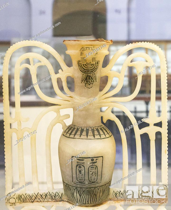 Stock Photo: Egypt, Cairo, Egyptian Museum, Tutankhamon alabaster, from his tomb in Luxor : Uppert part of an ornamental unguent vase.