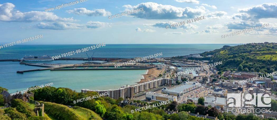 Stock Photo: 15 August 2019, England, Dover: Panoramic view from Dover Castle, which is one of the largest castles in England, to the town and the harbour.