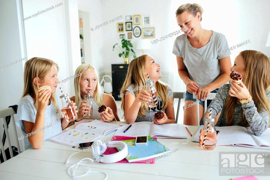 Stock Photo: Girls having snack while they learning together.